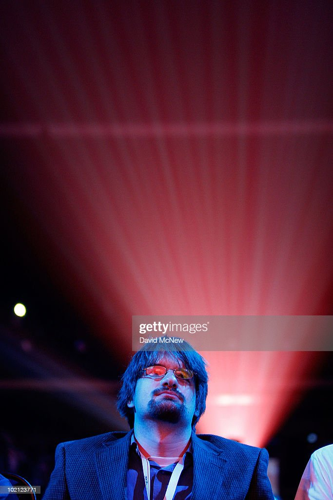 The rays of projected game videos shine above an audience member during the Nintendo presentation of new products at the Nokia Theater on opening day of the annual Electronic Entertainment Expo (E3), across the street at the Los Angeles Convention Center, on June 15, 2010 in Los Angeles, California. The Entertainment Software Association expects 45,000 people to attend the E3 expo featuring more than 250 gaming industry publishers and developers such as Nintendo, Microsoft and Sony.