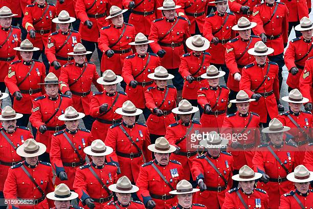 The RCMP red surge arrives at the Metro Toronto Convention Center for the day's activities surrounding the color funeral for a fallen Toronto Police...