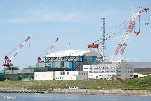 The reactor building for Electric Power Development Co's Oma nuclear power plant stands under construction in Oma Town Aomori Prefecture Japan on...