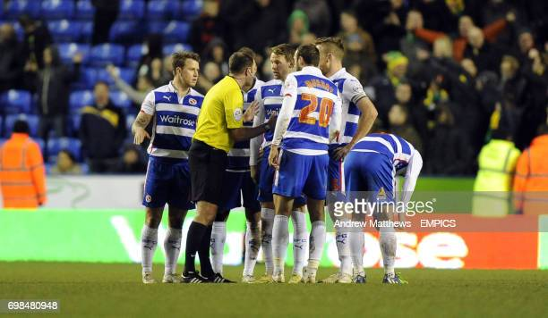 The Reading players talk to Referee James Linington after Norwich City's Bradley Johnson scores his side's first goal of the game before Reading had...