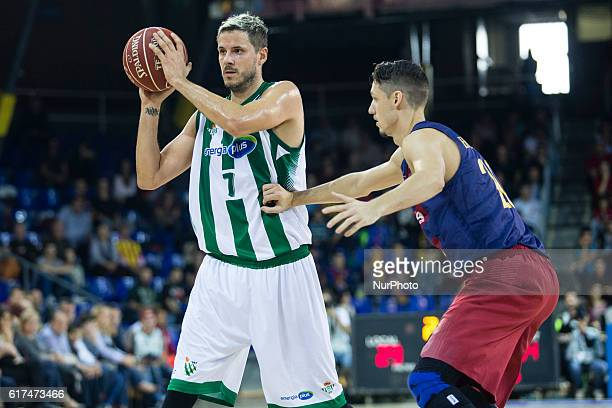 The Real Betis player Bostjan Nachbar from Slovenia in action defensed by The FC Barcelona player Marcus Eriksson from Sweden during the 2016/2017...