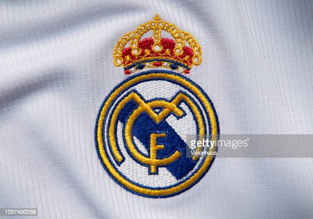 The Real Madrid club crest on the first team home shirt on July 19 2020 in Manchester United Kingdom