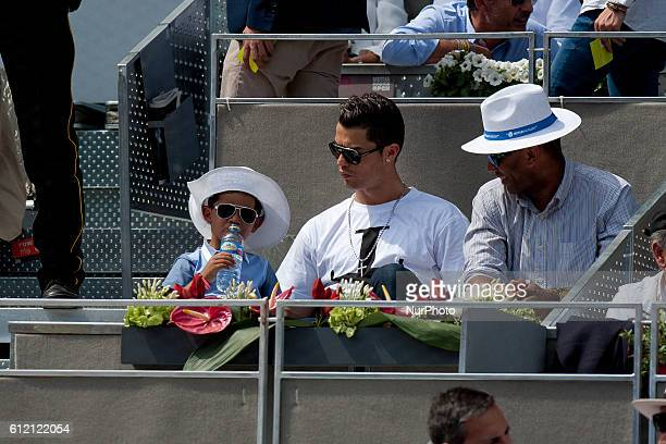 The Real Madrid player Cristiano Ronaldo attends with her son tennis match of Rafa Nadal in the Mutua Madrid Open tennis tournament at the Caja...