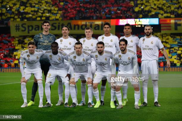 The Real Madrid players pose for a group photo prior to the Liga match between FC Barcelona and Real Madrid CF at Camp Nou on December 18, 2019 in...