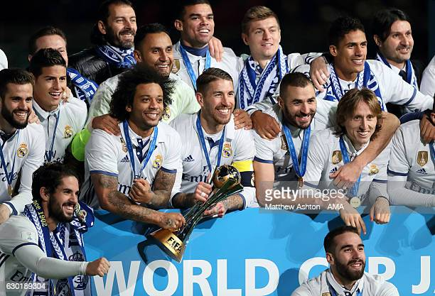 The Real Madrid players pose with the trophy at the end of the FIFA Club World Cup final match between Real Madrid and Kashima Antlers at...