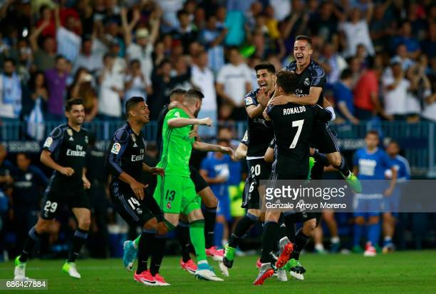 The Real Madrid squad celebrate being crowned champions following the La Liga match between Malaga and Real Madrid at La Rosaleda Stadium on May 21...