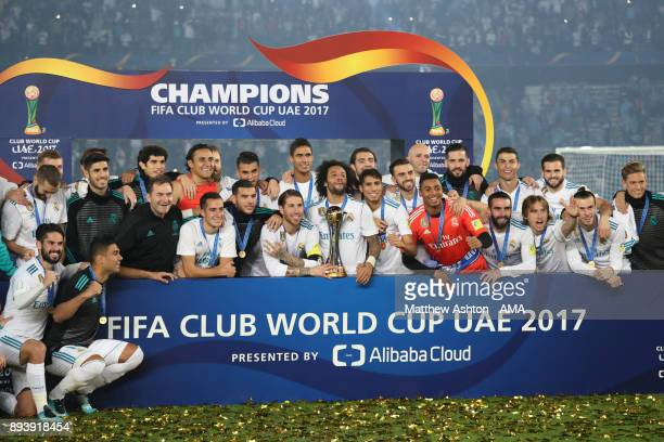 The Real Madrid squad celebrates with the trophy at the end of the FIFA Club World Cup UAE 2017 final match between Gremio and Real Madrid CF at...