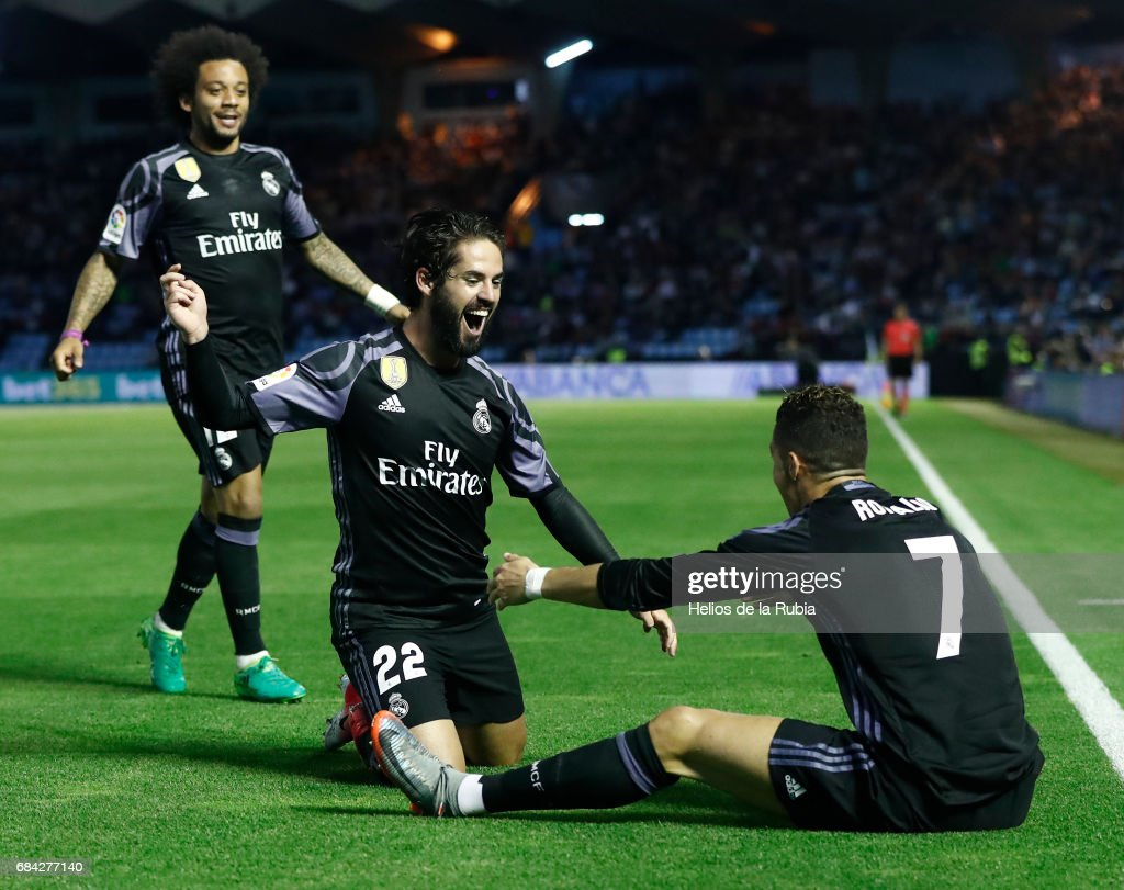 The Real Madrid team celebrate after scoring during the La Liga match between RC Celta de Vigo and Real Madrid CF at Estadio Balaidos on May 17, 2017 in Vigo, Spain.