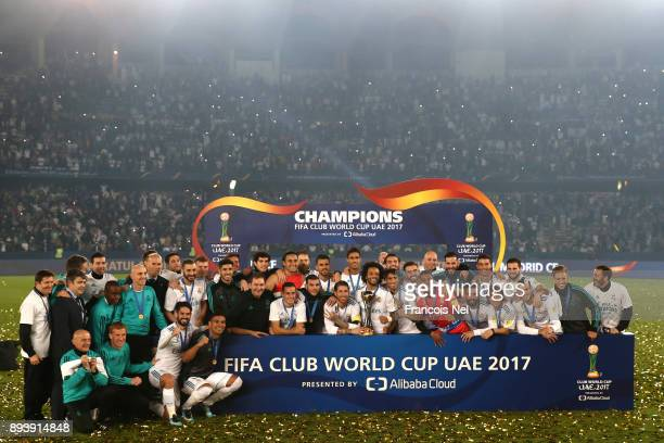 The Real Madrid team celebrate with the Trophy after the FIFA Club World Cup UAE 2017 Final between Gremio and Real Madrid at the Zayed Sports City...