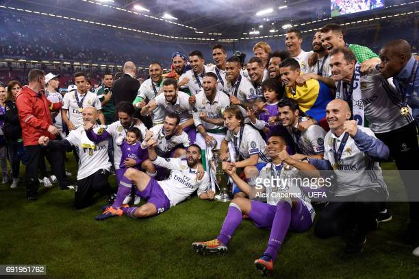 The Real Madrid team celebrate with the trophy after the UEFA Champions League Final between Juventus and Real Madrid at National Stadium of Wales on...