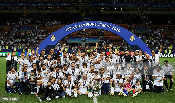 The Real Madrid team celebrate with the trophy during the UEFA Champions League Final between Real Madrid and Club Atletico de Madrid at Stadio...