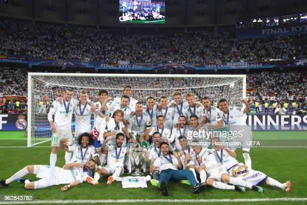 The Real Madrid team celebrate with UEFA Champions League trophy following their sides victory in the UEFA Champions League Final between Real Madrid...