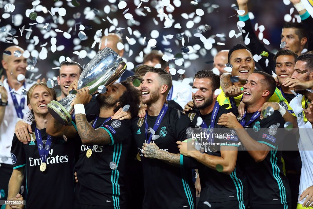 The Real Madrid team celebrate with UEFA Super Cup trophy after the UEFA Super Cup final between Real Madrid and Manchester United at the Philip II Arena on August 8, 2017 in Skopje, Macedonia.