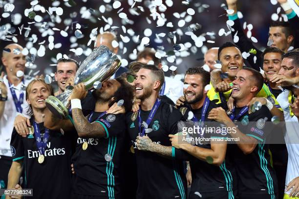The Real Madrid team celebrate with UEFA Super Cup trophy after the UEFA Super Cup final between Real Madrid and Manchester United at the Philip II...