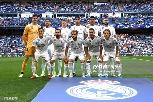 The Real Madrid team line up for a photo prior to the UEFA Champions League group A match between Real Madrid and Club Brugge KV at Bernabeu on...