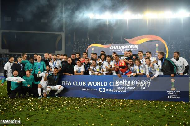 The Real Madrid team pose for a team photo with the trophy after the FIFA Club World Cup UAE 2017 Final between Gremio and Real Madrid at the Zayed...