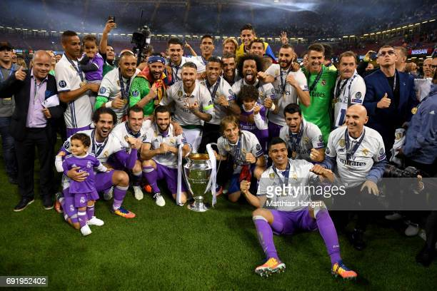 The Real Madrid team pose with the Champions League Trophy after the UEFA Champions League Final between Juventus and Real Madrid at National Stadium...