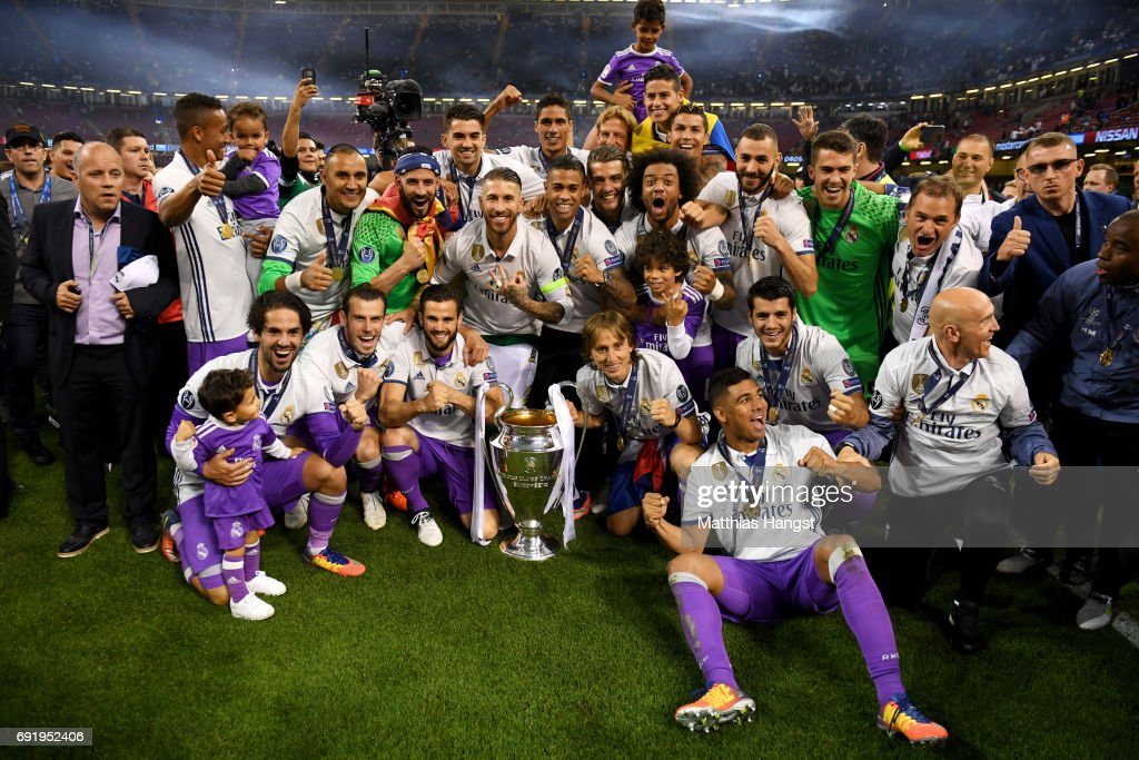 The Real Madrid team pose with the Champions League Trophy after the UEFA Champions League Final between Juventus and Real Madrid at National Stadium of Wales on June 3, 2017 in Cardiff, Wales.