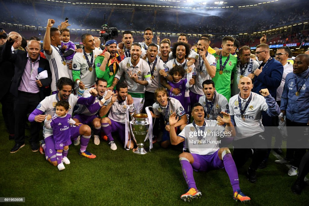 The Real Madrid team pose with the trophy after the UEFA Champions League Final between Juventus and Real Madrid at National Stadium of Wales on June 3, 2017 in Cardiff, Wales.