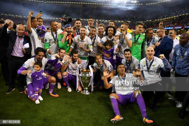 The Real Madrid team pose with the trophy after the UEFA Champions League Final between Juventus and Real Madrid at National Stadium of Wales on June...