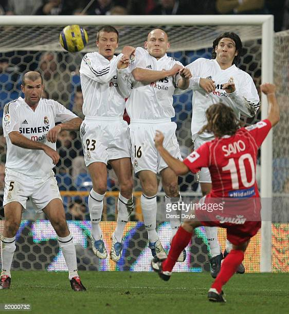 The Real Madrid wall of Zinedine Zidane, David Beckham, Thomas Gravesen and Santiago Solari blocks a free kick by Savio of Zaragoza during the...