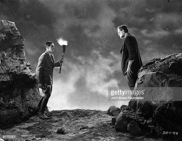 The reanimated monster played by English actor Boris Karloff meets his maker played by Colin Clive in 'Frankenstein' directed by James Whale