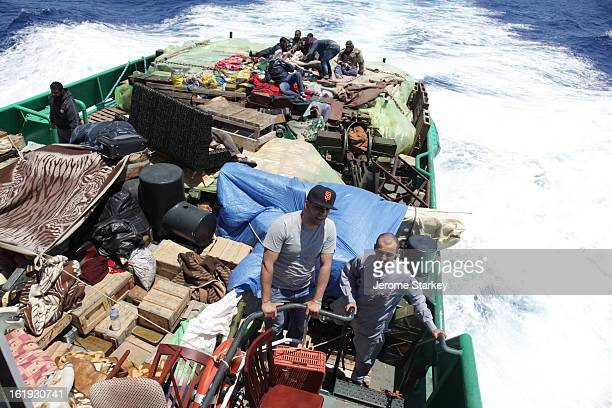The rear deck of a tug boat carrying guns and supplies to Libyan rebels in the besieged city of Misrata, May 13, 2010. The boat was not designed to...