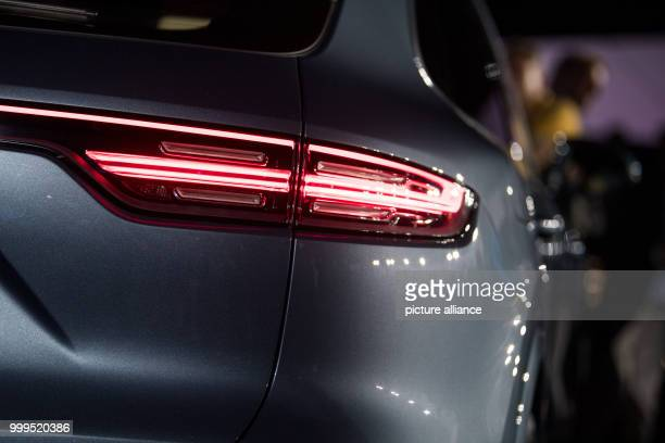 The rear light of the new Cayenne Generation blinks during its introduction at the Porsche Museum in Stuttgart Germany 29 August 2017 The 3 litre...