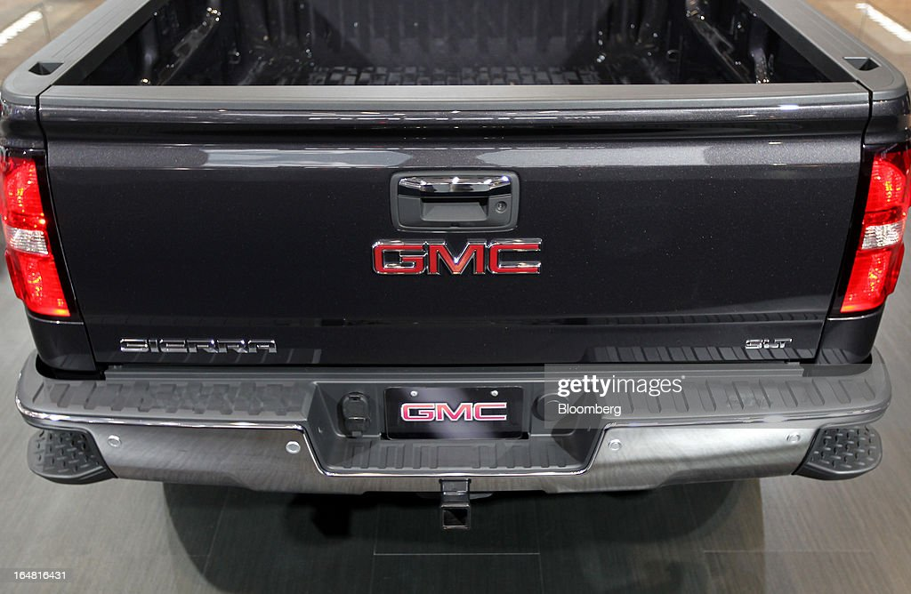 The rear of a General Motors Co. (GM) 2014 GMC Sierra is seen while on display at the company's booth during the 2013 New York International Auto Show in New York, U.S., on Thursday, March 28, 2013. The 113th New York International Auto Show, which runs from March 29 to April 7, features 1,000 vehicles as well the latest in tech, safety and innovation. Photographer: Jin Lee/Bloomberg via Getty Images