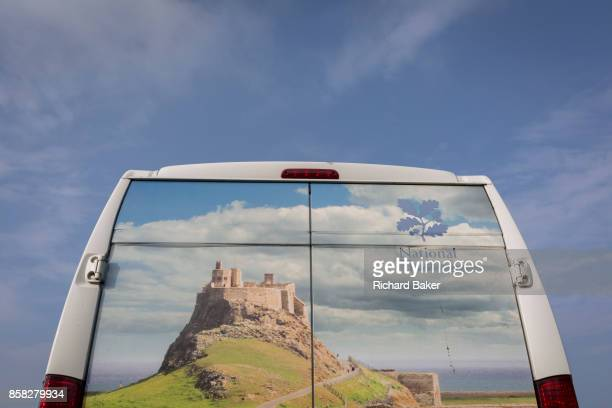 The rear of a National Trust membership van features Lindisfarne castle, on 27th September 2017, on Lindisfarne Island, Northumberland, England. The...