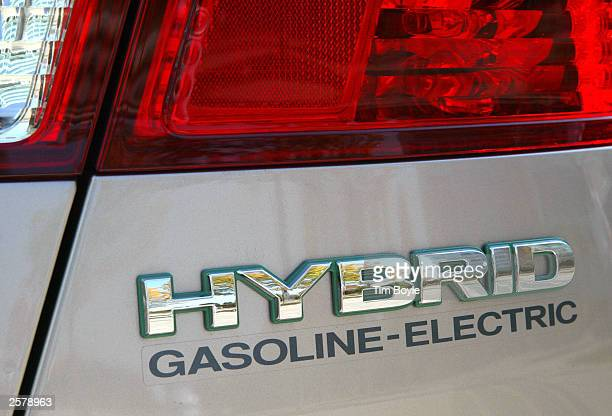 The rear of a new Honda Civic Hybrid automobile is seen during an exposition at the Motorola campus October 10 2003 in Deer Park Illinois Motorola...