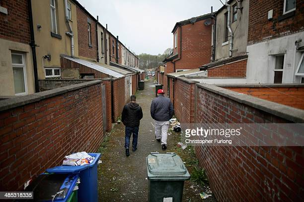 The rear of Equitable and Pioneer Streets in Rochdale, some of the first social houses built by the Rochdale Pioneers, the founders of the modern...