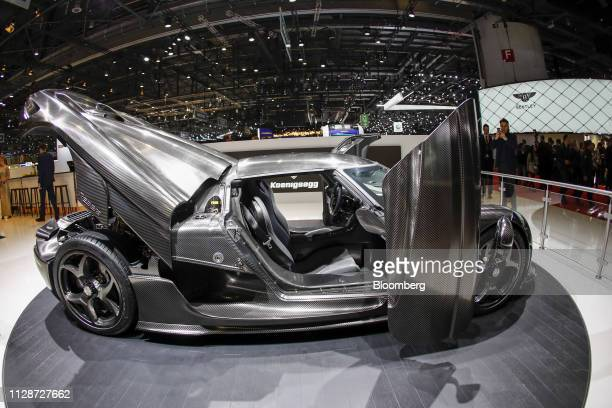 The rear trunk and dihedral doors sit open on a Koenigsegg Automotive AB Regera hybrid supercar on the opening day of the 89th Geneva International...