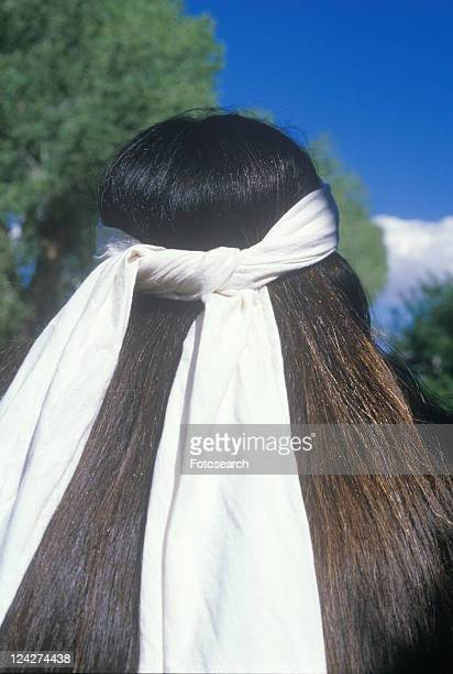 The rear view of a white head band on a Native American Cherokee