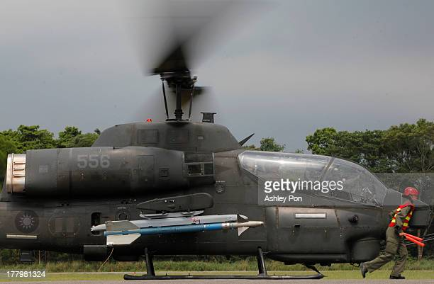 The rearmed AH1 'SuperCobra' Attack Helicopter is ready to take off during a military drill on August 26 2013 in Taichung Taiwan This is an annual...