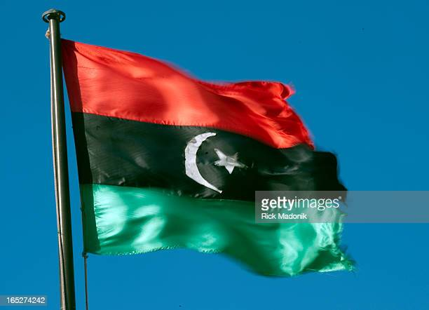 03/01/11 TOBRUK LIBYA The rebel Libyan flag waves in the wind outside a hotel in Tobruk Libya about 130 kms from the Egyptian border The flag has...
