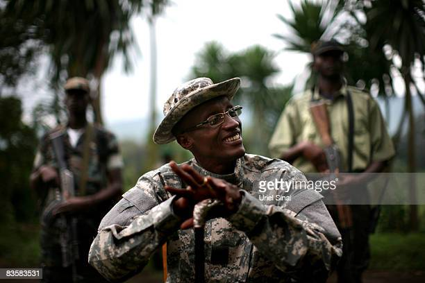 The rebel National Congress for the Defense of the People leader General Laurent Nkunda prepares to pose for a portrait at a CNDP headquarters on...