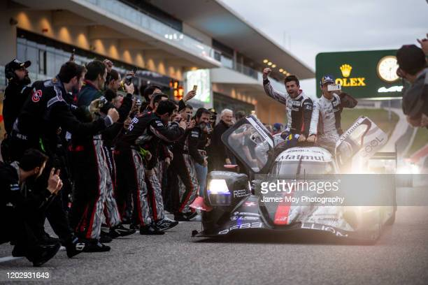 The Rebellion Racing R13 of race winners Gustavo Menezes, Norman Nato, and Bruno Senna enter parc ferme celebrating with the team at the end of the...