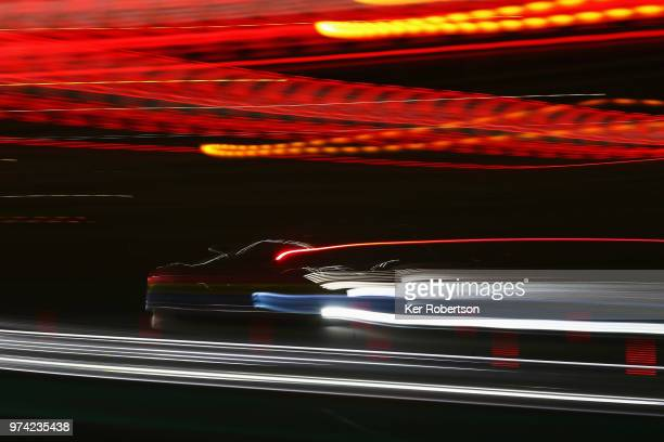 The Rebellion Racing R13 of Thomas Laurent Mathias Beche and Gustavo Menezes drives through Tertre Rouge corner during practice for the Le Mans 24...