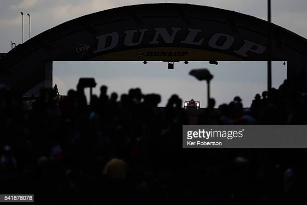 The Rebellion Racing ROne of Nicolas Prost Nick Heidfeld and Nelson Piquet Junior drives under the Dunlop Bridge during the Le Mans 24 Hour race at...