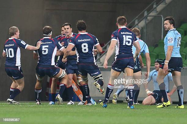 The Rebels celebrate after Tom English of the Rebels scored the first try of the match during the round 15 Super Rugby match between the Rebels and...