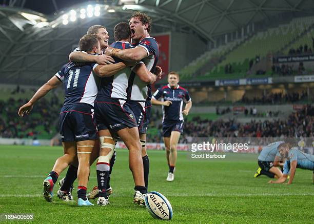 The Rebels celebrate after Tom English of the Rebels scored the matchwinning try during the round 15 Super Rugby match between the Rebels and the...