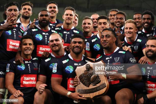 The Rebels pose with the Weary Dunlop Shield after victory in the round five Super RugbyAU match between the Melbourne Rebels and the NSW Waratahs at...