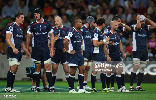 The Rebels stand behind their goal line after conceding a try during the round one Super Rugby match between the Melbourne Rebels and the Waratahs at...