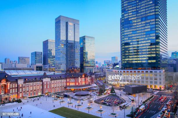 the reborn tokyo station at dusk, and the central part of tokyo, which is centered about tokyo station, marunouchi commercial district, japan - tokyo station stock photos and pictures