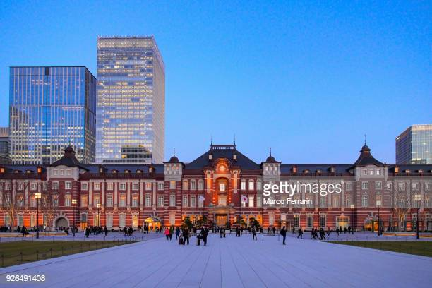 the reborn tokyo station at dusk, and the central part of tokyo, which is centered about tokyo station, marunouchi commercial district, japan - local landmark stock pictures, royalty-free photos & images