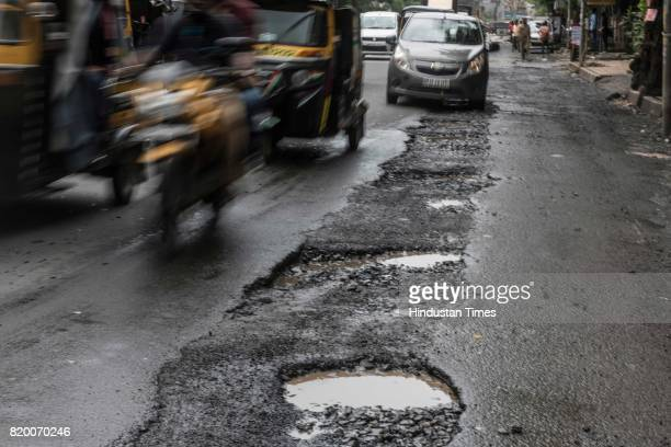 The recent heavy spell of showers has increased the problem of commuters as huge potholes have appeared on various roads in the city after rain at SV...