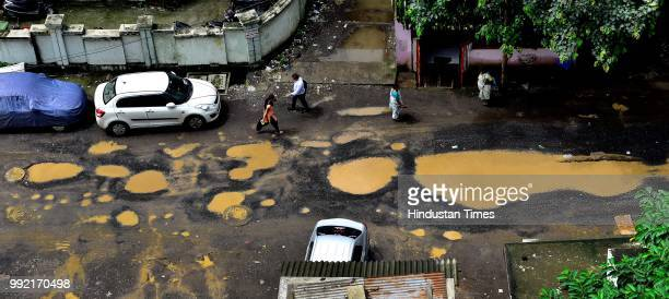 The recent heavy spell of showers has increased the problem of commuters as huge potholes have appeared on various roads in the city after rain at...