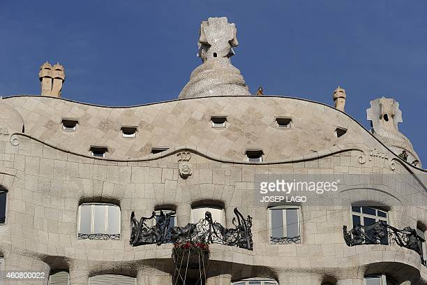 The recently renovated facade of Barcelona's casa Mila or 'Pedrera' emblematic modernist building by architect Antoni Gaudi is pictured on December...