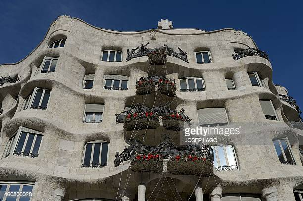 The recently renovated facade of Barcelona's casa Mila or Pedrera emblematic modernist building by architect Antoni Gaudi is pictured on December 23...